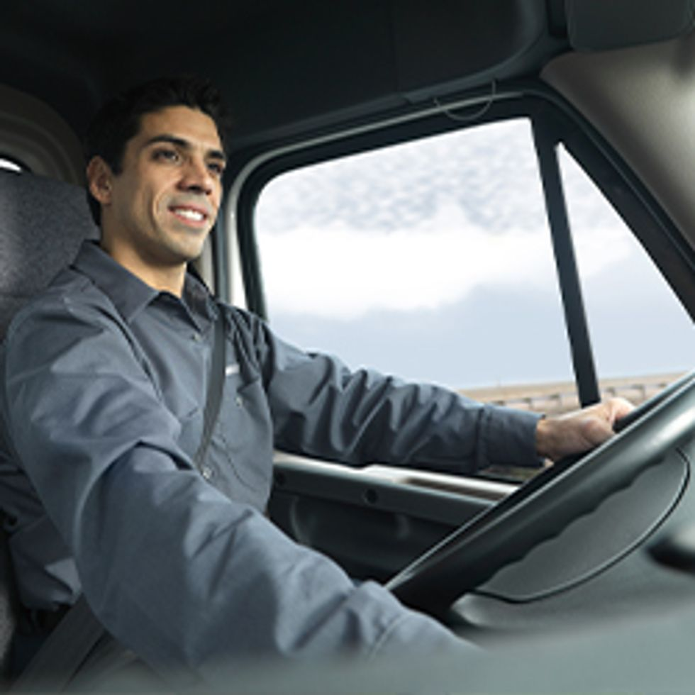 Driver in the Truck Holding Steering