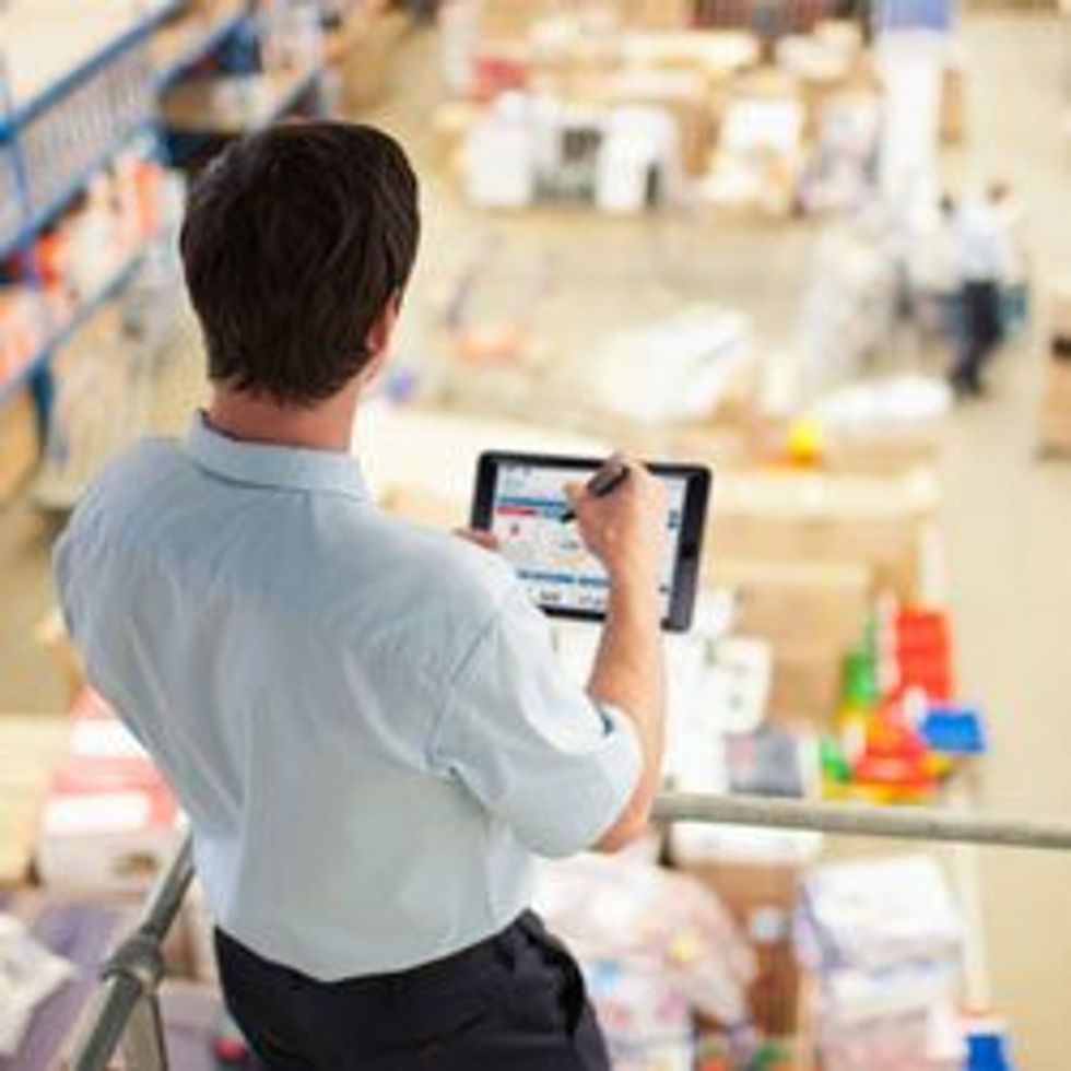 Man in warehouse with tablet