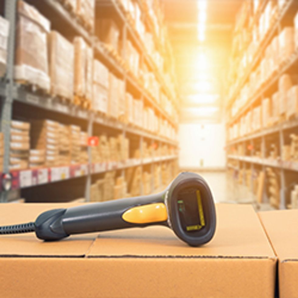 Barcode Scanner in Front of Modern Warehouse