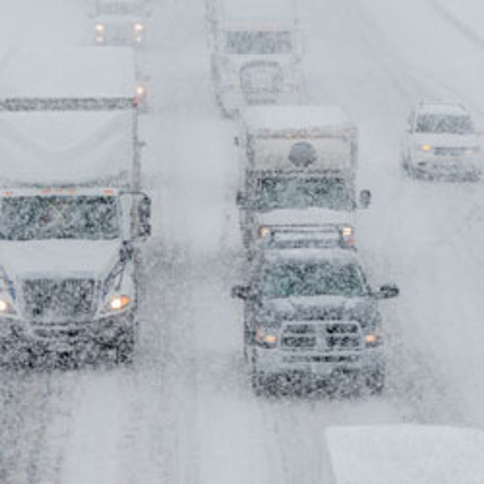 Snowy highway with traffic