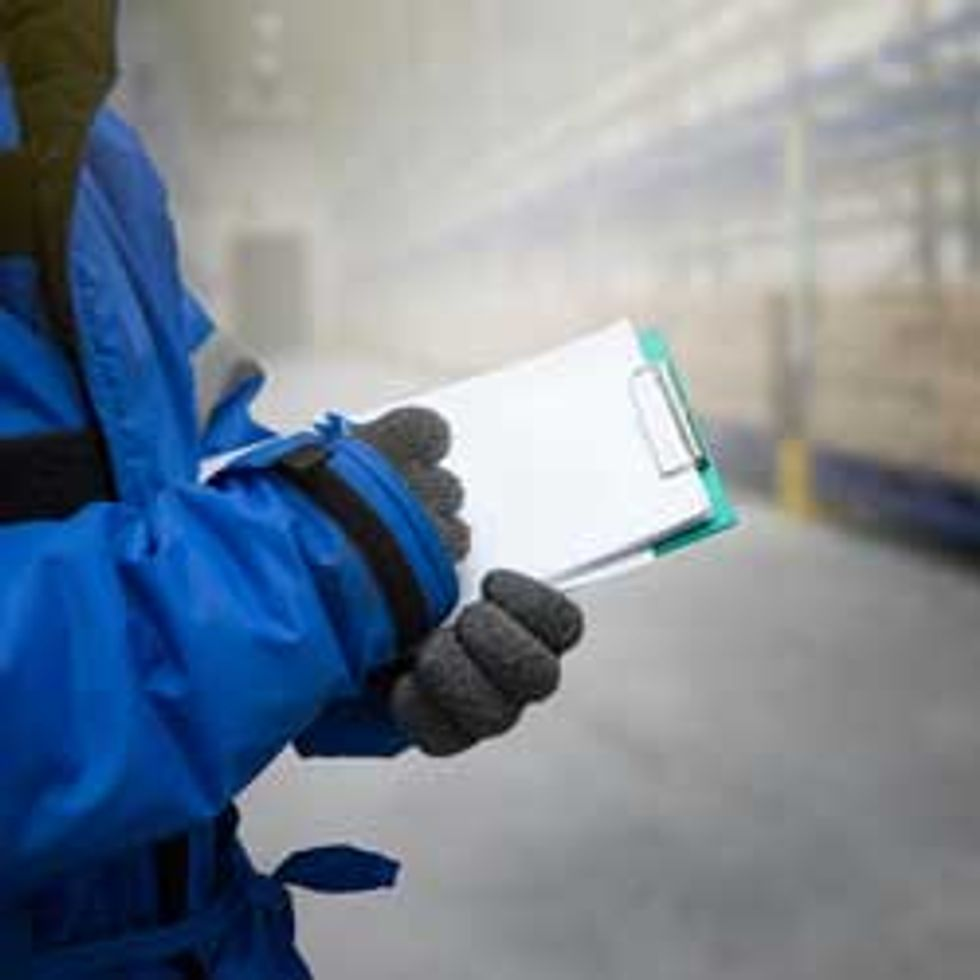 Cold storage worker with clipboard