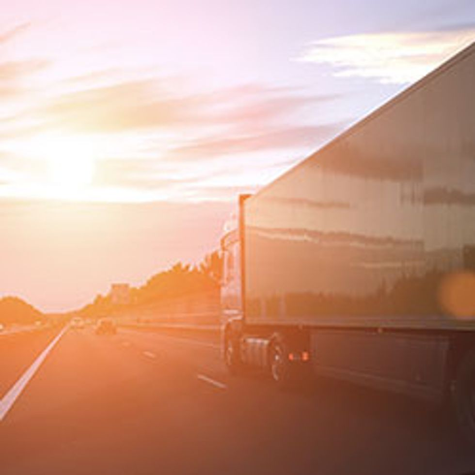 Cargo container truck highway road rural countryside sunset