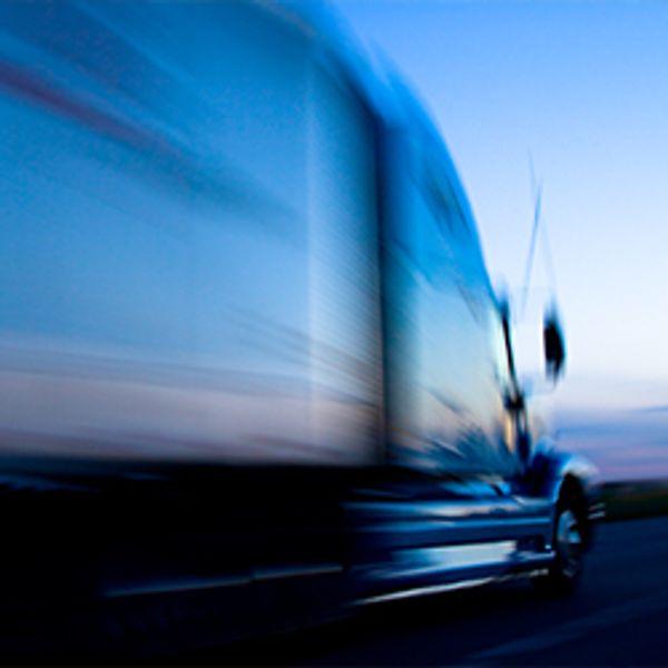 Truck Speeding Down the Freeway at Dusk