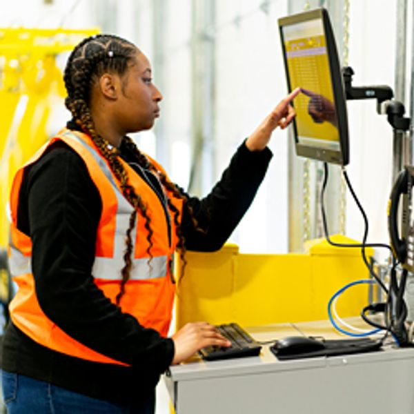 Warehouse worker viewing monitor