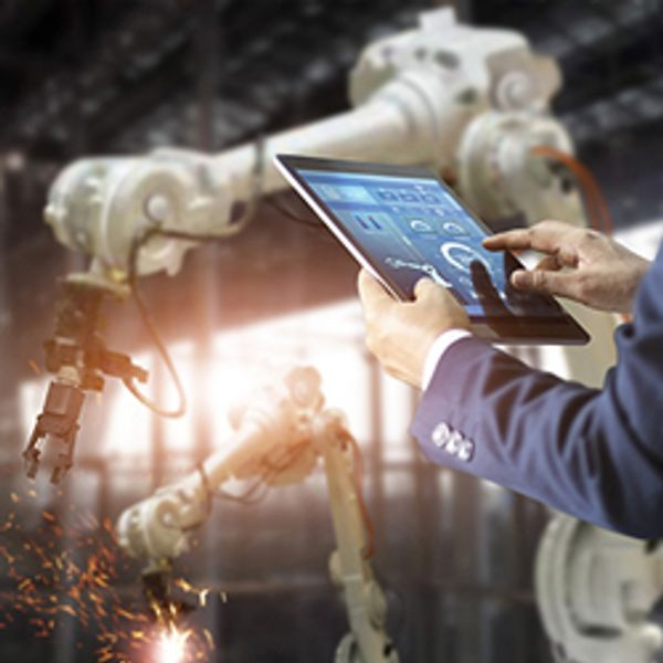 Manager using tablet to control automation robot